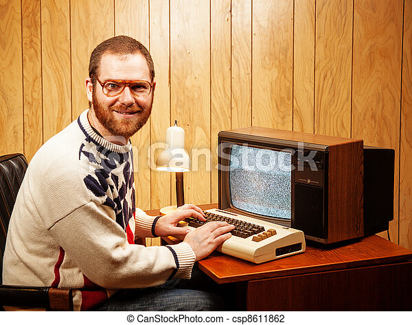 Handsome Nerdy Adult using a Vintage Computer TV - csp8611862