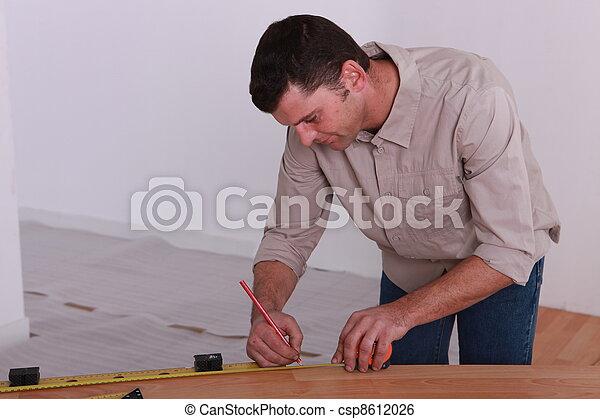 woodworker taking measurements - csp8612026