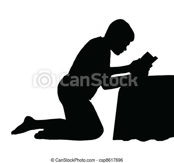 Child Reading Bible next to Bed - csp8617696