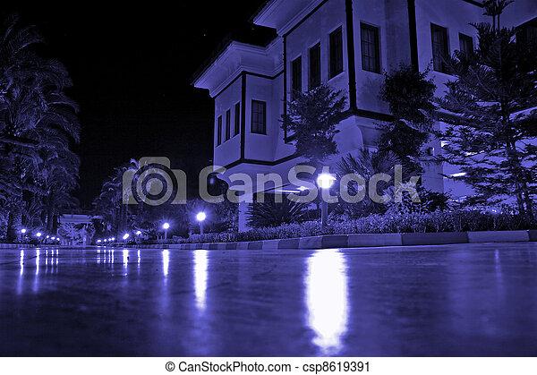 mansion with external illumination in warm summer night - csp8619391