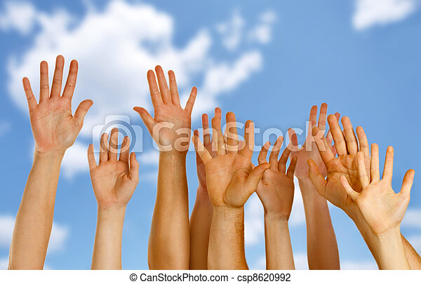Hands raised up in air across blue sky - csp8620992