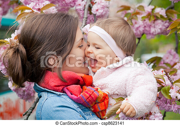 Mother with baby in the garden - csp8623141