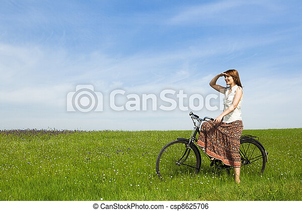 Girl with a bicycle - csp8625706