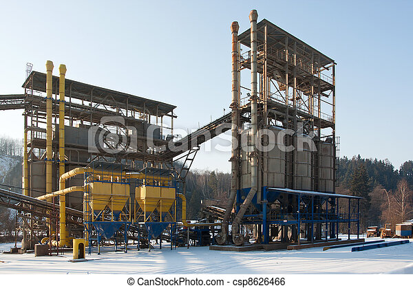 Stone quarry with silos, conveyor belts in winter - csp8626466