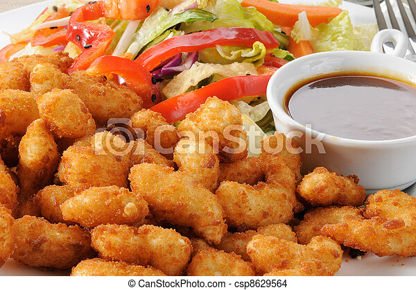Breaded shrimp and salad close up - csp8629564