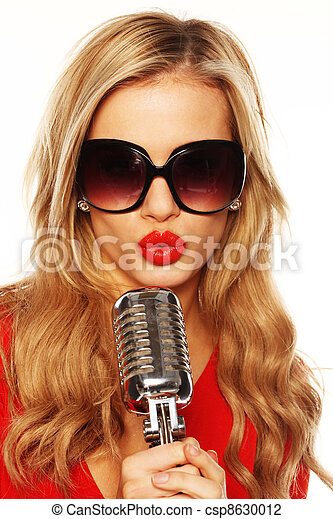 Gorgeous Blonde In Sunglasses With Microphone - csp8630012