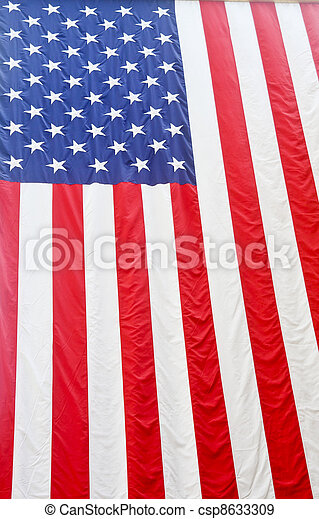 American Flag Hanging From Ceiling - csp8633309