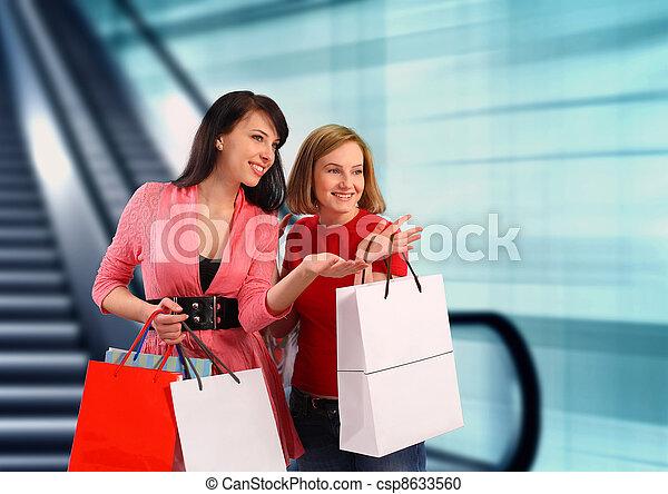 Two young women shopping - csp8633560
