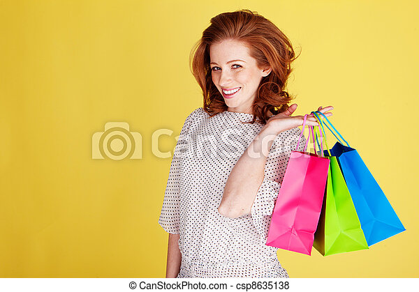 Happy Shopper With Colourful Bags - csp8635138