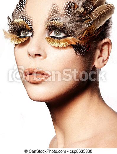 Creative Feathered Eye Makeup - csp8635338