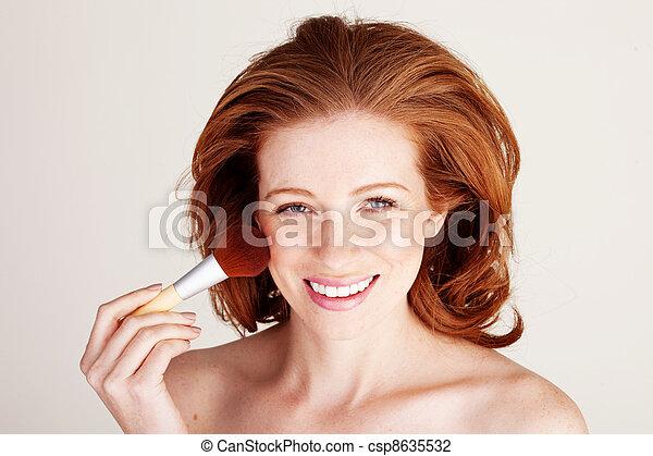 Smiling Woman Applying Blusher - csp8635532