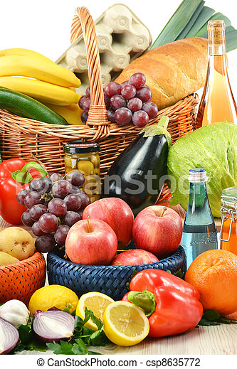 Composition with groceries and basket isolated on white. - csp8635772