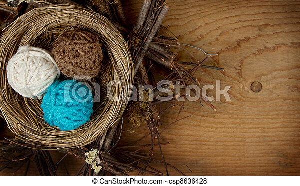 Balls of yarn in a nest - csp8636428
