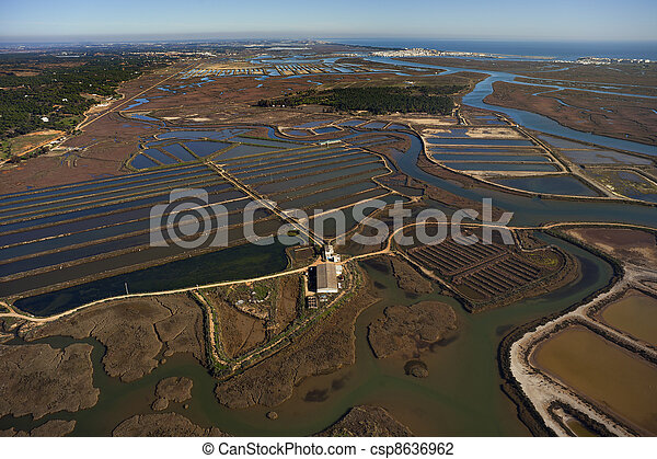 Aerial view of fish farms and salt marshes - csp8636962