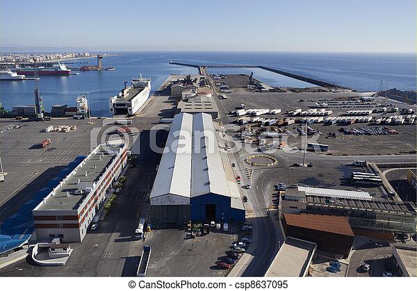 Aerial view over the Almeria harbour - csp8637095