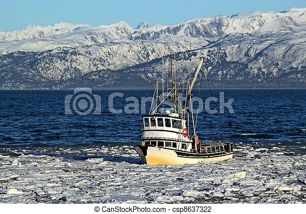 Classic fishing boat in an icy bay - csp8637322