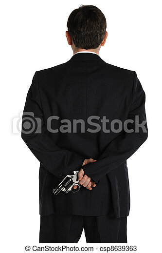 pistol behind the suit - csp8639363