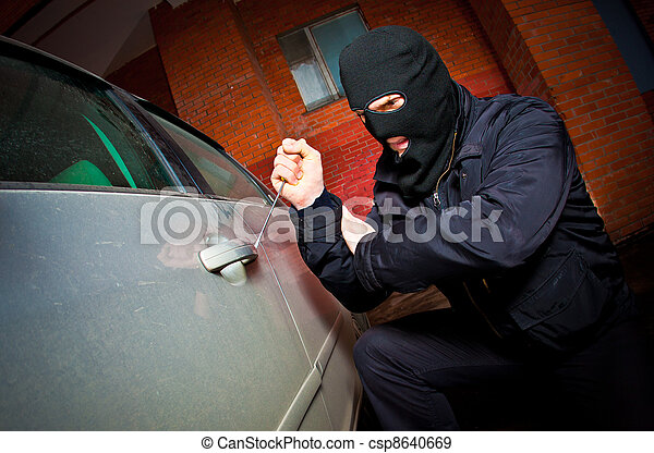 robber and the thief in a mask hijacks the car - csp8640669
