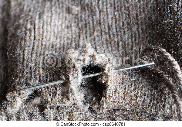 Mending a Hole in Clothing - csp8640781