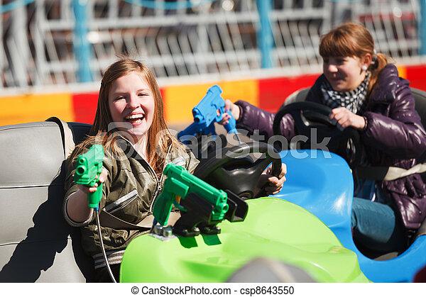 Teenage girls driving a bumper cars - csp8643550