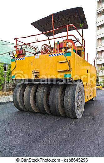 Steamroller on asphalt road from back - csp8645296