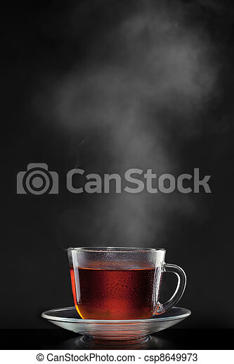 cup with hot tea and steam on black - csp8649973