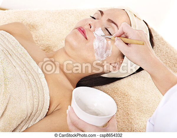 Beautician applying  facial mask by  woman. - csp8654332