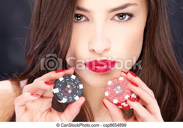 woman and gambling chips - csp8654899