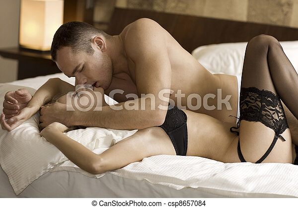 young couple in bed - csp8657084