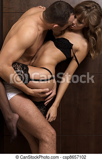 intimate young couple during  - csp8657102