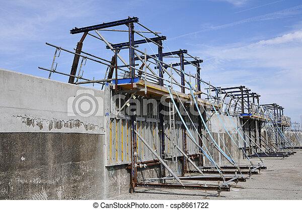 Builder's Yard which repair a concrete jetty - csp8661722