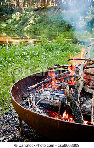 Campfire in the wilderness - csp8663809