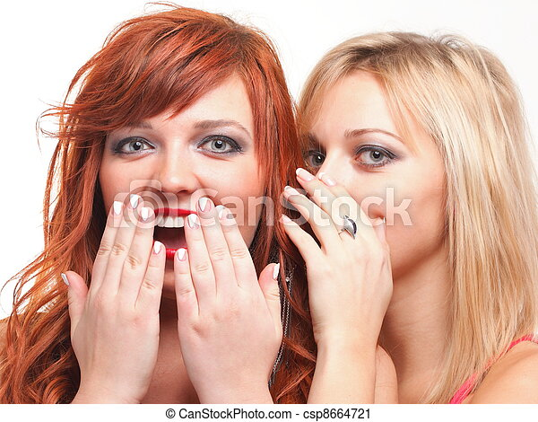 two happy young girlfriends blond and ginger talking white background - society gossip, rumor, rumour - csp8664721