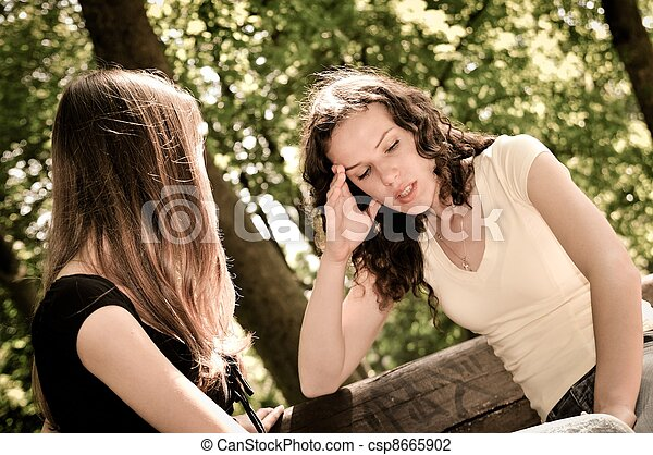 Friends - one teenage girl comforts another - csp8665902