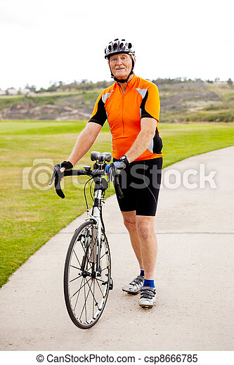 senior man standing by his road bicycle  - csp8666785
