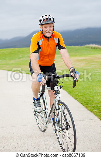 happy active senior man riding bicycle - csp8667109