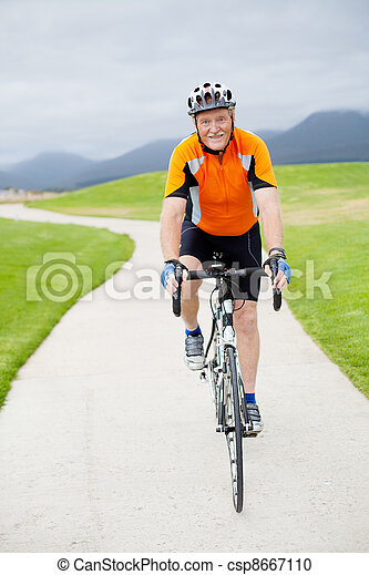 active senior man riding a road bicycle - csp8667110