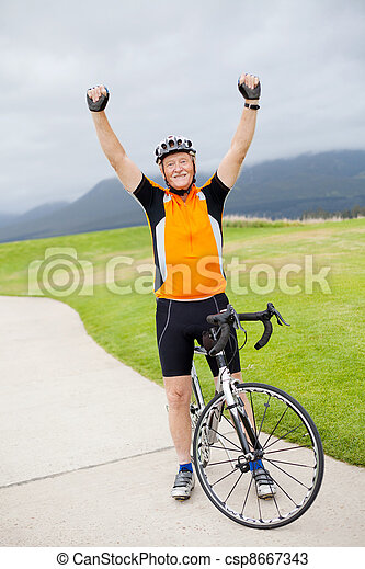 cheerful active senior man arms up - csp8667343
