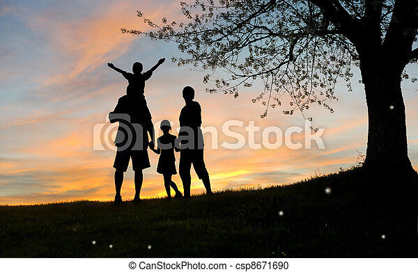 Happy family, father, mother, son and daughter in nature, sunsett - csp8671690
