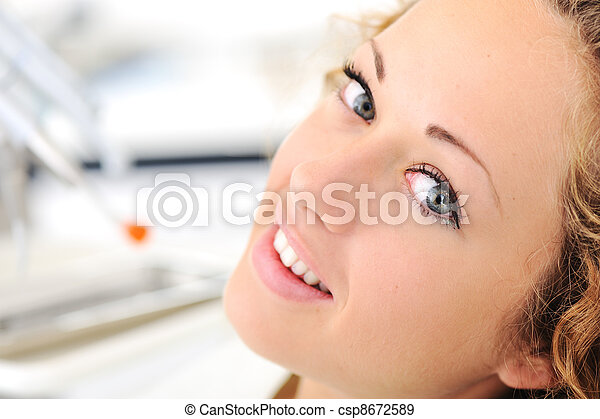 Beautiful young woman at dentist office - csp8672589