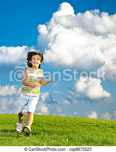 Fantastic scene of happy children running and playing carefreely on green meadow in nature - csp8673523