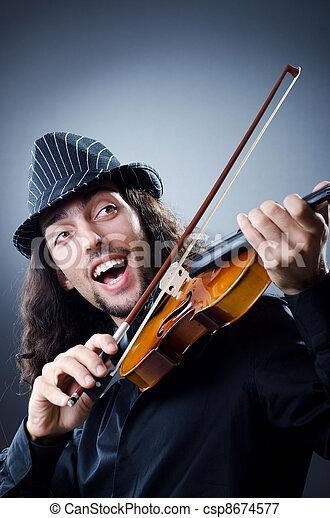 Gypsy violin player in studio - csp8674577