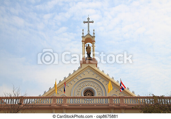 Gable of church which statue on top. - csp8675881