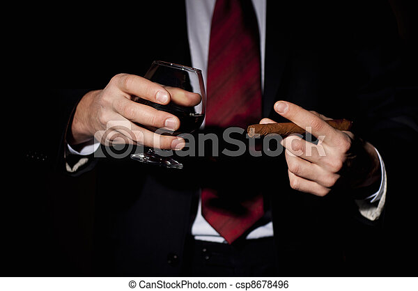 rich person, holds a cigar and whisky - csp8678496