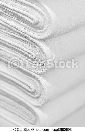 Stack of new white towels close-up - background - csp8680698