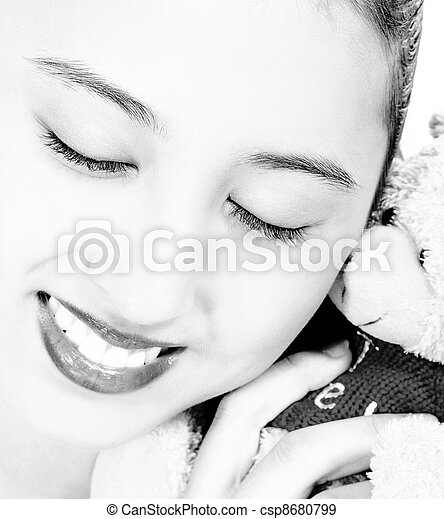 Pretty Teenager Cuddling A Cute Teddy Bear - csp8680799