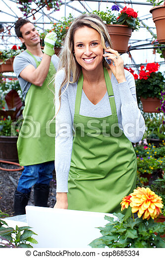 Florist woman working at flower shop. - csp8685334