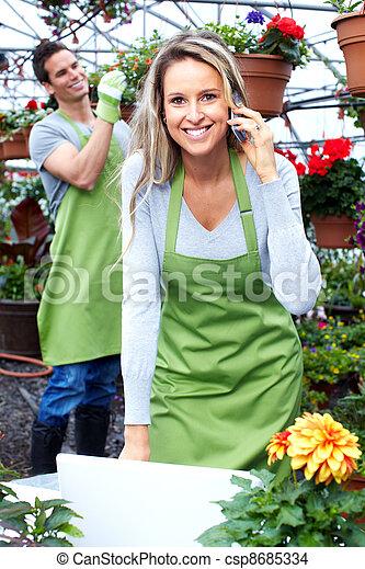 Florist woman working at flower shop. - csp8685334