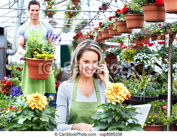 Florist woman working at flower shop. - csp8685336