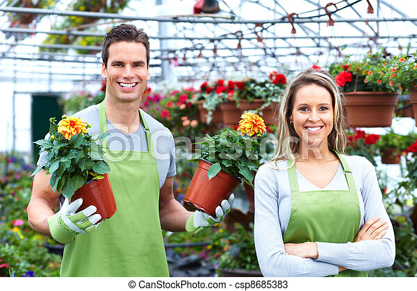 Florists couple working at flower shop. - csp8685383